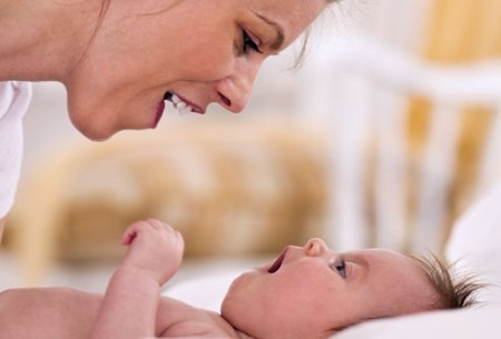 Baby imitating mom